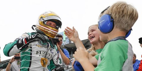 Ed Carpenter is congratulated by his kids Mackenna, Ryder and Cruz.
