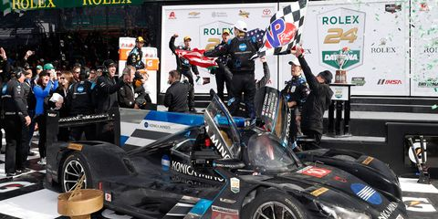 Jeff Gordon, Ricky Taylor, Jordan Taylor and Max Angelelli celebrate their victory for Cadillac at Daytona International Speedway on Sunday.