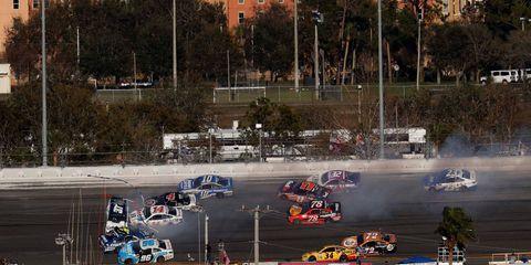 Race track, Motorsport, Automotive tire, Racing, Sports car racing, Auto racing, Race car, Touring car racing, Stock car racing, Race of champions,