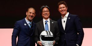 Tsunehisa Okuno, NTT's executive vice president, head of global business is flanked by IndyCar drivers Tony Kanaan, left, and defending NTT IndyCar Series champion Scott Dixon were all smiles in Detroit on Tuesday.