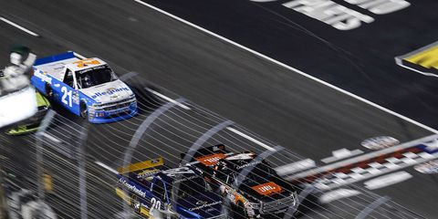 Christopher Bell won a close duel with Chase Briscoe Friday night at Texas Motor Speedway.