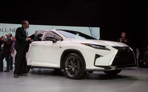 The 2016 Lexus RX350 and RX450h on the 2015 New York auto show floor