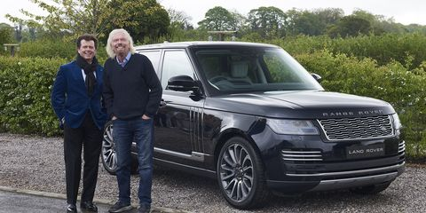 Gerry McGovern and Richard Branson pose next to an Astronaut Edition Range Rover.