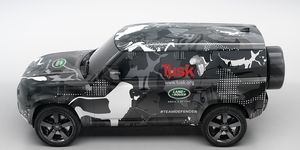 The latest publicity shot shows the Defender without the fake hood and roof camouflage.