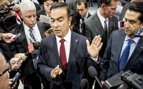 Nissan CEO Carlos Ghosn talks to reporters following the unveiling of the Maxima.
