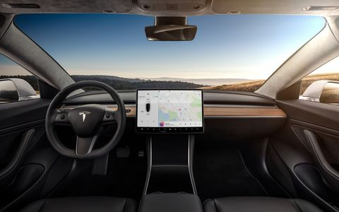 The dash is stark, dominated by that huge touchscreen, which negates the necessity of all those other buttons and knobs.
