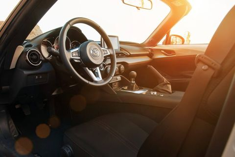 The 2018 Mazda MX-5 Miata has a curb weight of 2,332 pounds.