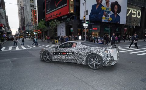 Here are the first official photos of the C8 Corvette, still camouflaged, being driven through New York with Corvette chief engineer Tadge Juechter at the wheel and GM ceo Mary Barra riding shotgun. Look for the official C8 reveal July 18.