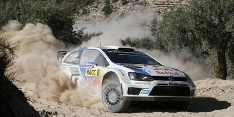 Sebastien Ogier successfully defended his World Rally Championship title with a victory for Volkswagen in Spain on Sunday.