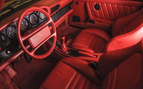 The 1988 Porsche 959 Komfort features a very red interior.