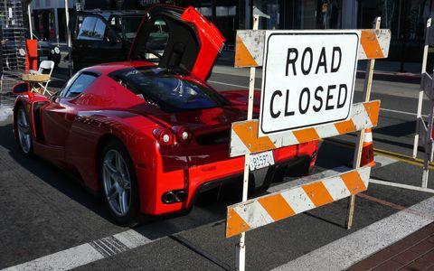 The road is closed to all but classic Ferraris, including this Enzo.