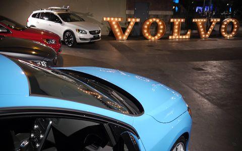 Modern Volvos surround their namesake.