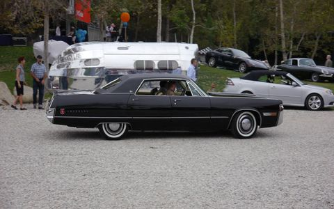 Futurist and Art Center alum (BS '59) Syd Mead pilots his '72 Chrysler Imperial Le Baron onto the grass.