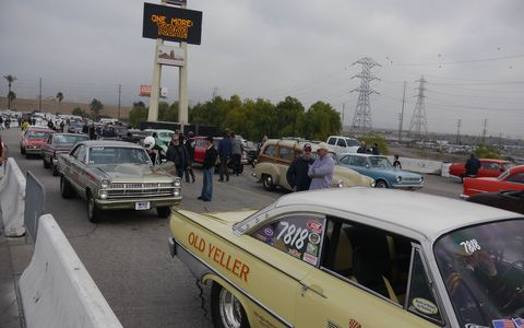 """It just ain't Xmas without the MoonEyes Xmas Car Show and Dragz: hundreds of lead sleds, customz, bombz and other items ending in """"z."""" With the T-shirt shacks to go with 'em. There were also live bands and real drag racin'. Go Moon!"""
