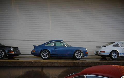 Hundreds of beautiful (and two or three battered) air-cooled Porsches rolled into the fourth fabulous Luftgekeulht, held this year near the docks in San Pedro. A little rain in the morning kept the weak and feeble away and left only the true believers.