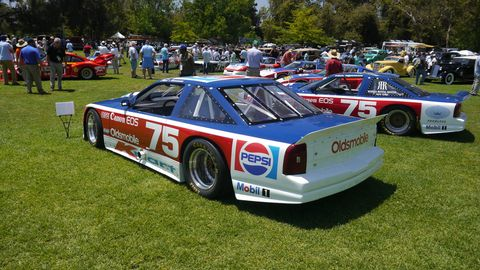 Adam Carolla brought ten race cars formerly driven by Paul Newman.