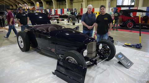 A total of 14 entries are vying this year for the title of America's Most Beautiful Roadster at the Grand National Roadster Show in Pomona Friday through Sunday. Here two generations of the Moal family - Steve and David - stand by their entry in the AMBR competition.
