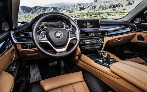 The distinctive style of the new BMW X6's interior is captured in the sports leather steering wheel with multifunction buttons. (The xDrive50i is shown here)