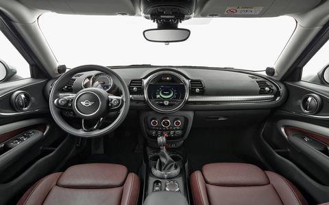 Land vehicle, Vehicle, Car, Center console, Motor vehicle, Steering wheel, Vehicle audio, Family car, Automotive design, Design,