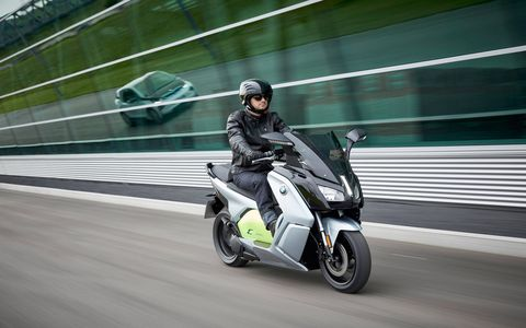 The BMW C evolution electric scooter is a whole different way of looking at transportation. With a 94-Ah battery it offers 48 hp and 53 lb ft of torque. Range is listed at 99 miles, a lot more than we got. Starting price is $13,750. Note the i3 in the reflection?