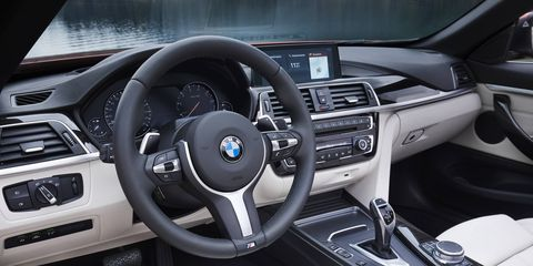 Inside, the BMW 430i features chrome accents, a gloss black center console and double stitching on the instrument panel.