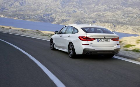 """The BMW 6 Series Gran Turismo features a long trunk, the set-back cabin position, a wheelbase of 120.9 inches, doors with frameless windows, and a slim window graphic that leads into a more vertical interpretation of the signature BMW """"Hofmeister kink""""."""