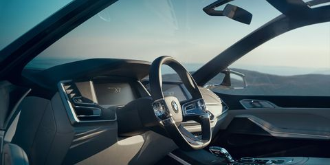 """The X7's interior is """"reduced to the essentials"""" according to BMW, except for the huge 12.3-inch screen behind the wheel and central infotainment screen next to it."""
