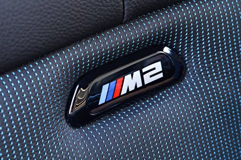 The BMW M2 Competition interior gets minor updates, like illuminated M2 logos and new dynamic memory buttons.