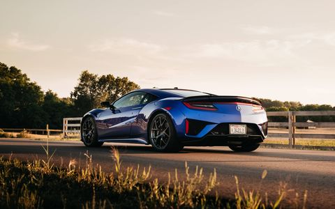 The 2017 Acura NSX basking in the setting sun
