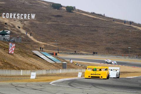 Three 917s approach Turn 11 at WeatherTech Raceway Laguna Seca.