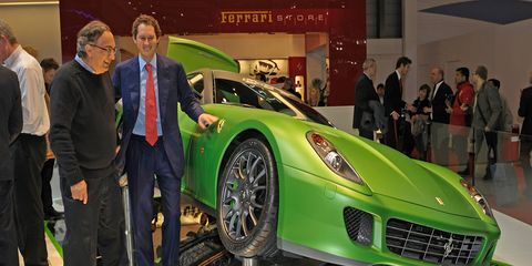 Fiat Group CEO and Ferrari chairman Sergio Marchionne, left, with Fiat chairman John Elkann.
