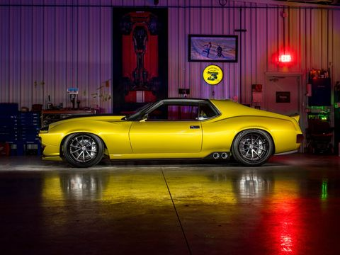"""The Ring Brothers, whose company name is Ringbrothers, have made some pretty outrageous muscle cars over the years. The latest is this 1036 hp AMX Javeline, sponsored by Prestone, hence the color. Custom license plate reads, """"Coolant."""""""