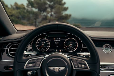 The wood and leather and other high-end materials that make up the 2019 Bentley Continental GT Convertible interior
