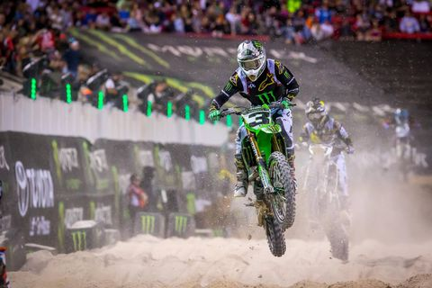 Eli Tomac rode his Kawasaki to victory - three victories in all three races of the event, to be precise - in the 2018 Monster Energy Cup at Sam Boyd Stadium in Las Vegas. By winning all three of the evening's races Tomac also won $1 million, presented in a fluorescent green-glowing metal case.
