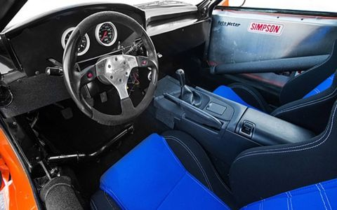 The interior features a number of upgrades, including a roll cage and competition seats.