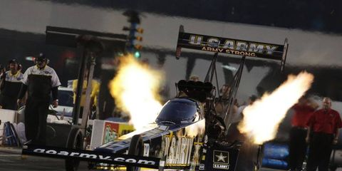 Tony Schumacher will be back to defend his NHRA title in 2015.