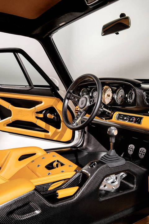"The 1990 Porsche 911 ""reimagined by Singer"" has a parallax white exterior and a Norfolk yellow interior."