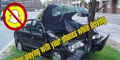 While not a picture of the official accident, it should still serve as a reminder to not play with your phone while driving.