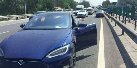 The Model S scraped a parked Volkswagen as the driver, by his own admission, was distracted.