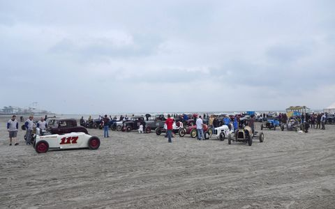Saturday morning. With rain approaching, the pits are chock full of cool cars and bikes.