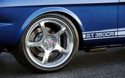 American Racing Torque Thrust wheels, 17x8 front, 17x9 rear.