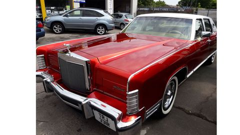 A madman genius in England swapped a Mercedes V12 into this 1977 Lincoln Continental.