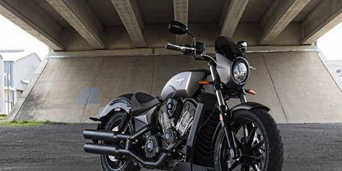 Motorcycle, Automotive tire, Mode of transport, Automotive design, Fuel tank, Automotive lighting, Rim, Automotive wheel system, Spoke, Fender,