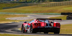 Tommy Kendall and racing journalists give the racing Ford GT for a final spin at Virginia International Raceway.
