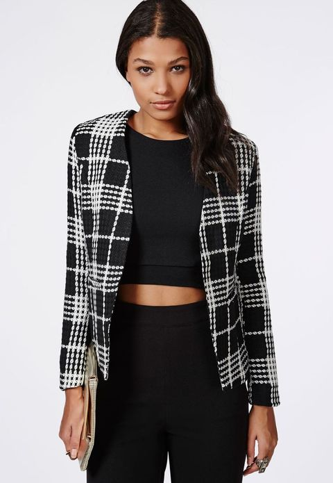 Young woman in a black and white tartan wool jacket by MissGuided.