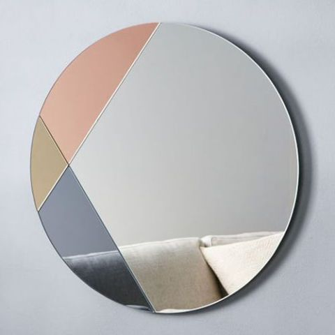 """<p><strong><em>$129, </em></strong><strong><em><a href=""""http://www.westelm.com/products/colorblocked-mirror-round-w2266/"""" target=""""_blank"""">westelm.com</a></em><a href=""""http://www.westelm.com/products/colorblocked-mirror-round-w2266/"""" target=""""_blank""""></a></strong><a href=""""http://www.westelm.com/products/colorblocked-mirror-round-w2266/"""" target=""""_blank""""></a></p><p>Part mirror, part art piece — this frameless pick flawlessly mixes metallics to accent your space in an unexpectedly new way.</p><p><strong>More: </strong><a href=""""http://www.bestproducts.com/home/decor/g1444/hanging-mobile-art/"""" target=""""_blank"""">11 Mesmerizing Mobiles to Delight the Kid in All of Us</a></p>"""