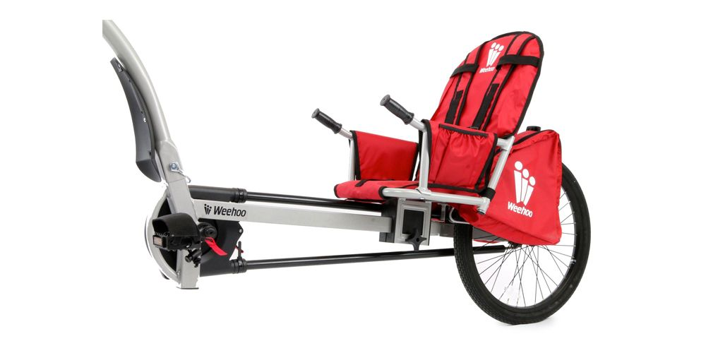 """<p><strong data-redactor-tag=""""strong""""><i data-redactor-tag=""""i"""">$399<a href=""""http://www.competitivecyclist.com/weehoo-turbo-bicycle-trailer-for-kids"""" target=""""_blank"""" class=""""slide-buy--button"""">BUY NOW</a></i></strong><br></p><p>We love this option because it has a set of pedals for your kid.Whether you like it because it gives your child a sense of contribution, or because you just don't want to work as hard, is up to you. It's built to stay balanced on winding roads, and your rug rat will bestrapped in with an adjustable three-point harness.</p>"""