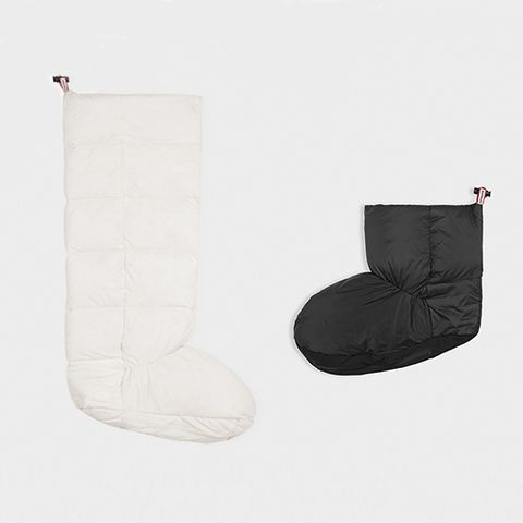 "<p><strong data-redactor-tag=""strong"" data-verified=""redactor""><em data-redactor-tag=""em"" data-verified=""redactor"">Hunter Tall Down Boot Socks, $65</em></strong> <a href=""http://us.hunterboots.com/socks/original-down-boot-socks/black/2591"" target=""_blank"" class=""slide-buy--button"" data-tracking-id=""recirc-text-link"">BUY NOW</a></p>  <p><strong data-redactor-tag=""strong"" data-verified=""redactor""><em data-redactor-tag=""em"" data-verified=""redactor"">Hunter Short Down Boot Socks, $55</em></strong> <a href=""http://us.hunterboots.com/socks/original-down-chelsea-boot-socks/black/2830"" target=""_blank"" class=""slide-buy--button"" data-tracking-id=""recirc-text-link"">BUY NOW</a></p>  <p>Convert a pair of trusted rain boots into insulated snow boots by adding these down boot sock inserts. They have bungee-style drawstrings so you can secure them around your ankles or upper calves, depending on what style boot you have, to keep any draft or snow from coming down the boot shaft. Your feet will stay extra warm, even if you're ankle-deep in snow or slush. Though they are made by Hunter for use with their original rain boots, these inserts fit with most other brands as well. </p>"
