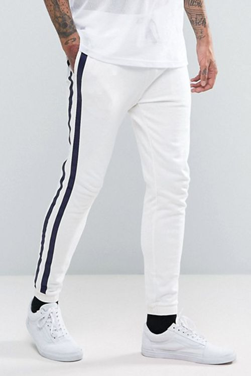 "<p><strong data-redactor-tag=""strong"" data-verified=""redactor""><em data-redactor-tag=""em"" data-verified=""redactor"">$40</em></strong> <a href=""http://us.asos.com/asos/asos-skinny-joggers-with-taping-in-white/prd/7790439?iid=7790439&clr=White&SearchQuery=&cid=14274&pgesize=204&pge=0&totalstyles=413&gridsize=3&gridrow=15&gridcolumn=2"" target=""_blank"" class=""slide-buy--button"" data-tracking-id=""recirc-text-link"">BUY NOW</a></p><p>To keep your street style on the right track, try out ASOS' tapered white track bottoms for a lean look. These skinny white joggers have the comfort and stretch of a track bottom, but keep your look tight and fresh with a tailored fit. They pair perfectly with an oversized jacket or hoodie for a cool outfit proportion play.</p><p><strong data-redactor-tag=""strong"" data-verified=""redactor"">More: </strong><a href=""http://www.bestproducts.com/mens-style/g1402/jackets-for-men/"" target=""_blank"" data-tracking-id=""recirc-text-link"">Find the Right Men's Jacket to Beat the Heat in Style</a><span class=""redactor-invisible-space"" data-verified=""redactor"" data-redactor-tag=""span"" data-redactor-class=""redactor-invisible-space""><a href=""http://www.bestproducts.com/mens-style/g1402/jackets-for-men/""></a></span></p>"