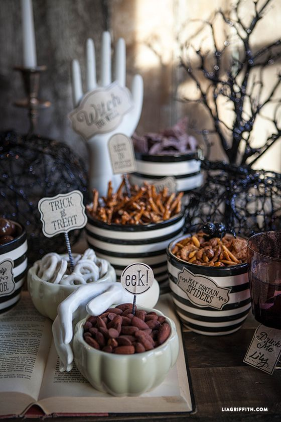 """<p>If you're hosting a more casual Halloween affair, you can still deck out your dining table without having fancy schmancy centerpieces. Use designerLia Griffith's free printables to create a spooky spread of your Halloween apps.</p><p><strong data-redactor-tag=""""strong"""" data-verified=""""redactor"""">Get the tutorial at <a href=""""http://liagriffith.com/halloween-party-printables/"""" target=""""_blank"""">Lia Griffith</a>.</strong></p>"""